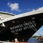 """Picture of large yacht called """"Business Skills to stay afloat"""" to publicise the Business of Therapy course run by Susan Wallace"""